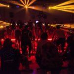 Fotografia de evento de spinning con iluminación espectacular
